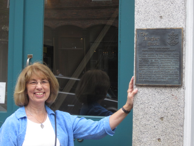 Susann Bishop, beside The Mosher Press plaque.